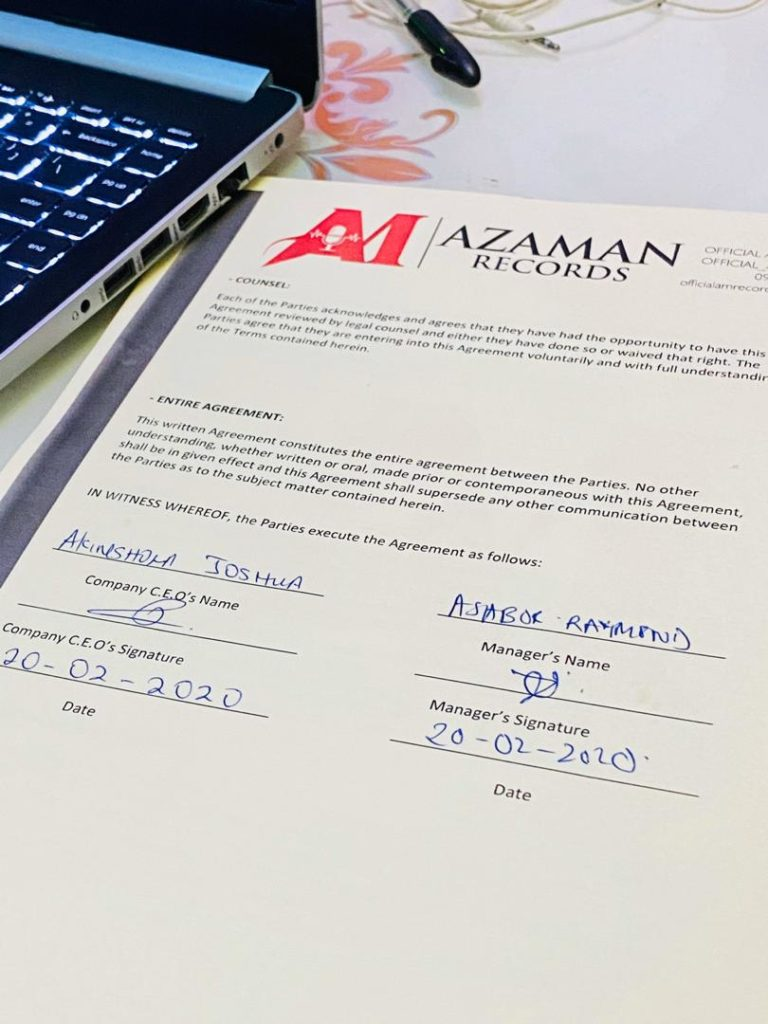 Signing Azaman Records Managing Director, Director Ray.